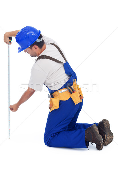 Handy man or construction worker measuring Stock photo © lightkeeper