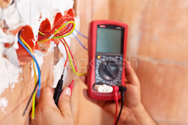 Stock photo: Electrician working - closeup on hands