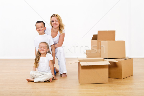 Woman and kids unpacking in their new home Stock photo © lightkeeper