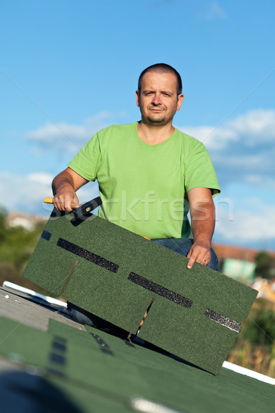 Roofer on top of building Stock photo © lightkeeper
