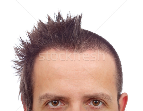 Male upper half face with funny haircut and copyspace on large f Stock photo © lightkeeper