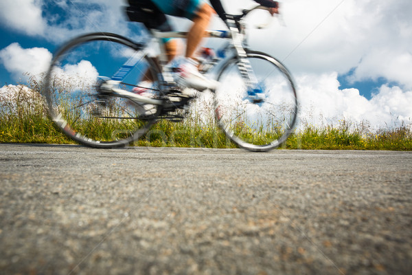 Motion blurred biker on a mountain road Stock photo © lightpoet