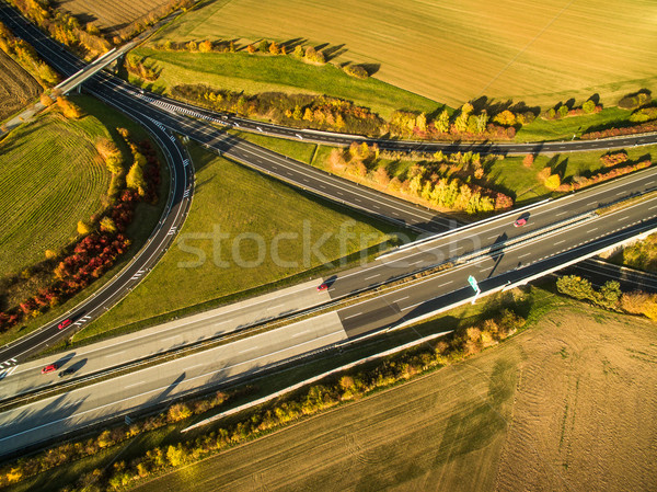 Aerial view of a highway amid fields with cars on it Stock photo © lightpoet
