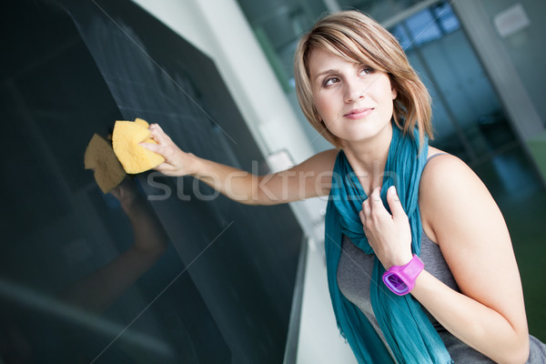 pretty college student erasing the chalkboard Stock photo © lightpoet