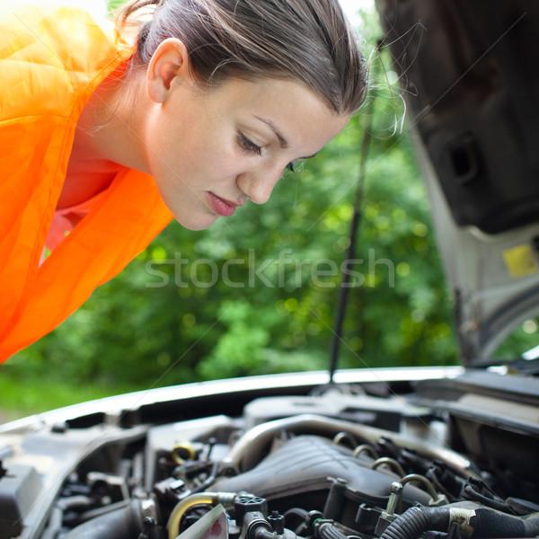 Jonge vrouwelijke bestuurder motor gebroken Stockfoto © lightpoet