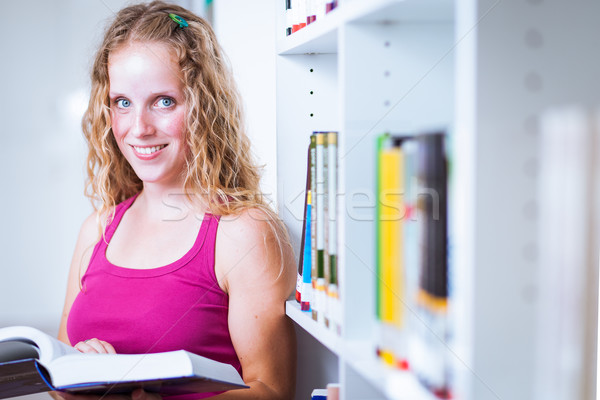 Pretty, young  female college student in a library Stock photo © lightpoet
