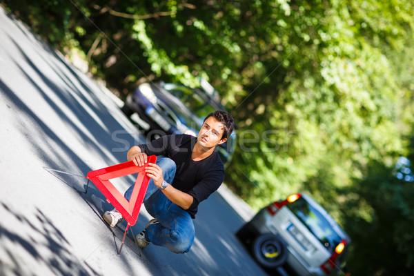 Knap jonge man auto gebroken beneden kant van de weg Stockfoto © lightpoet