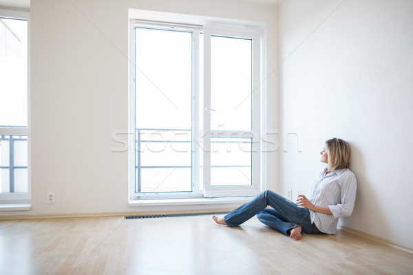 Just moved in: beautiful young woman finally sitting down  Stock photo © lightpoet