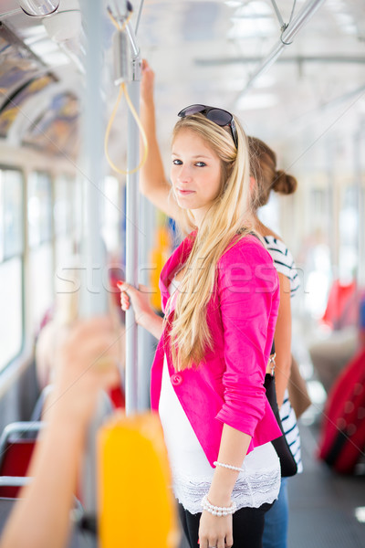 Stock photo: Pretty, young woman on a streetcar/tramway