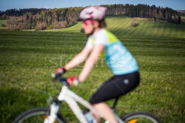 Stock photo: Female mountain biker out of focus with in focus landscape in th