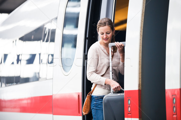 Pretty young woman boarding a train Stock photo © lightpoet
