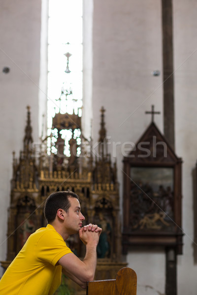 Handsome young man praying in a church Stock photo © lightpoet