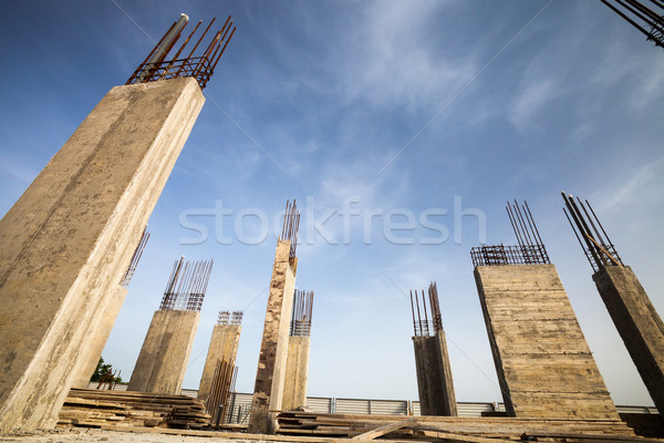 Construction site - Pillars of a building in the making against  Stock photo © lightpoet