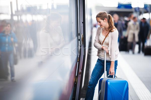 Csinos fiatal nő vasútállomás város vonat városi Stock fotó © lightpoet