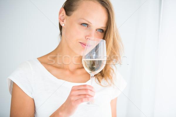 Genç kadın cam şarap içmek yudum Stok fotoğraf © lightpoet