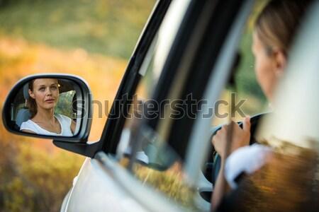 Csinos fiatal nő vezetés autó tükröződés oldal Stock fotó © lightpoet