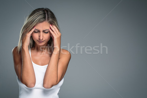 Gorgeous young woman with severe headache/migraine/depression  Stock photo © lightpoet