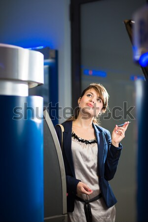 Pretty, young woman withdrawing money from her credit card Stock photo © lightpoet