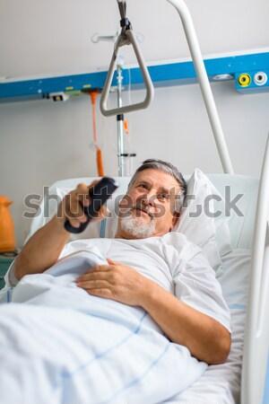 doctor or nurse talking to patient in hospital Stock photo © lightpoet