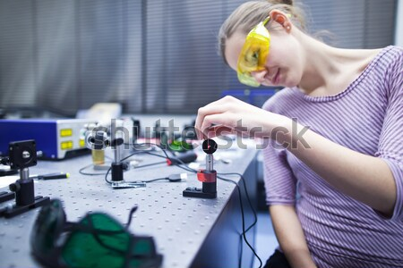 Female scientist carrying out research experiments in a lab Stock photo © lightpoet
