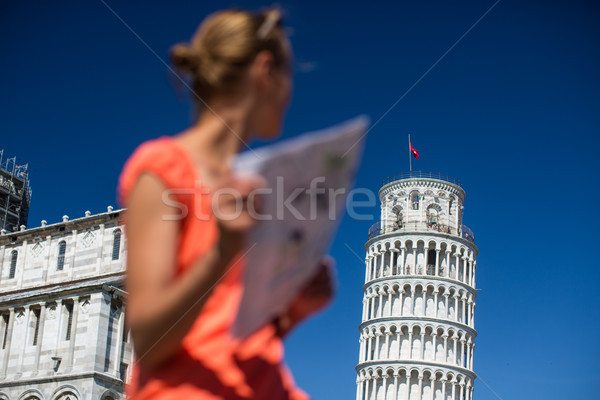 Gorgeous female tourist with map admiring the Leaning Tower of Pisa Stock photo © lightpoet