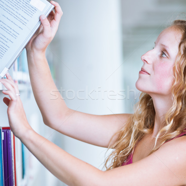 pretty female college student in a library Stock photo © lightpoet