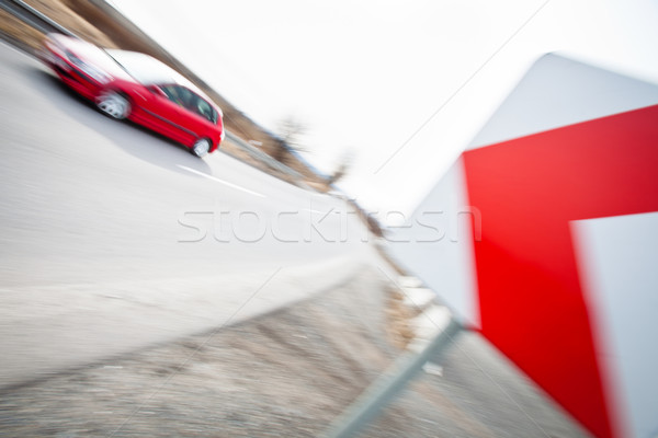 Traffic concept: car driving fast through a sharp turn  Stock photo © lightpoet