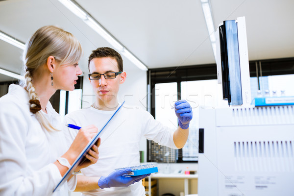 Two young researchers carrying out experiments in a lab  Stock photo © lightpoet