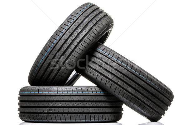Stock photo: Stack of brand new high performance car tires on clean high-key