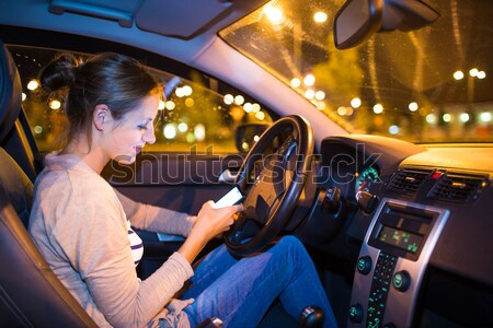 Female drive driving a car at night  Stock photo © lightpoet