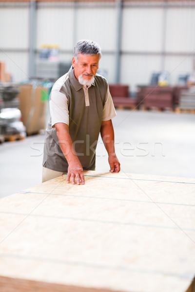Senior man buying construction wood in a  DIY store Stock photo © lightpoet