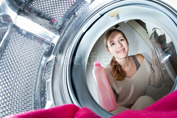 Housework: young woman doing laundry Stock photo © lightpoet