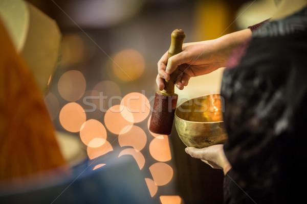 Man playing on a tibetian singing bowl Stock photo © lightpoet