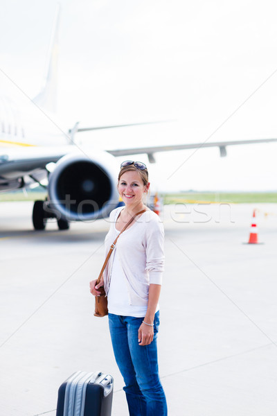 young woman at an airport having just left the aircraft Stock photo © lightpoet