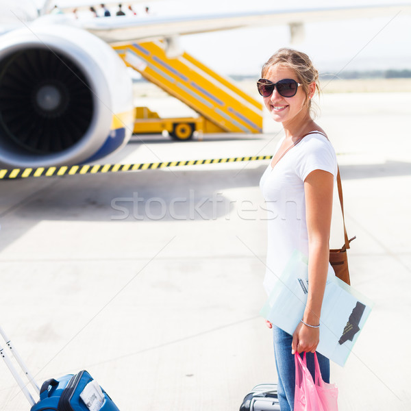 Departure - young woman at an airport about to board an aircraft Stock photo © lightpoet