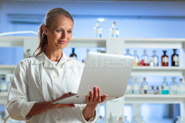 Stock photo: Portrait of a female researcher doing research in a chemistry lab