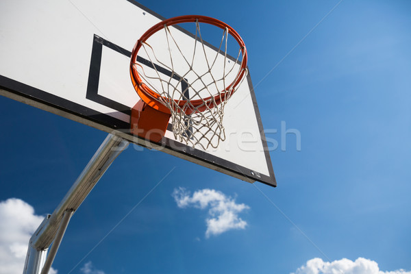 Basketball hoop against  lovely blue summer sky Stock photo © lightpoet