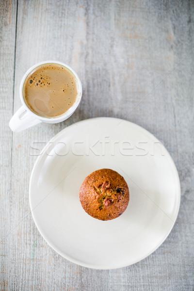 Reggel kávé muffin nyami étel kéz Stock fotó © lightpoet