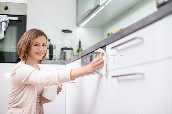 Young woman doing housework, cleaning the kitchen Stock photo © lightpoet