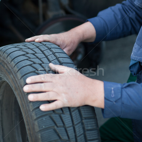 mechanic changing a wheel of a modern car (color toned image) Stock photo © lightpoet