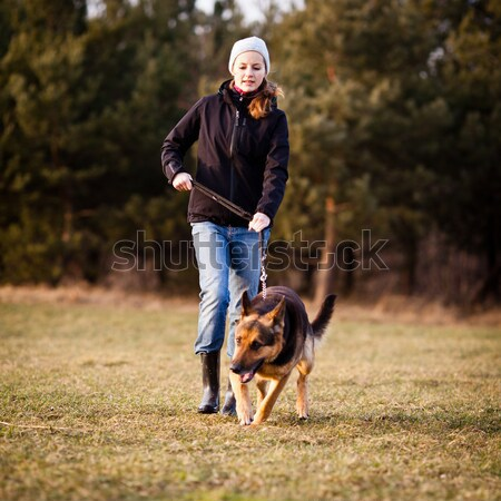 Stock photo: Master and her obedient dog