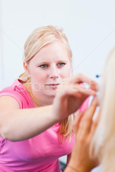 Fiatal női beteg szemek szemorvos csinos Stock fotó © lightpoet
