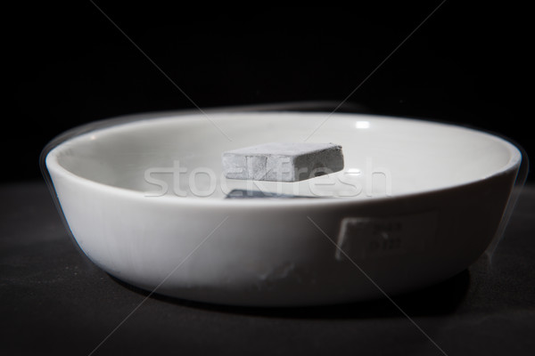 Stock photo: Physics in action - experiment with supraconductive materials