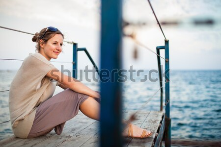 Portrait of a young woman on a jetty at the seacoast  Stock photo © lightpoet