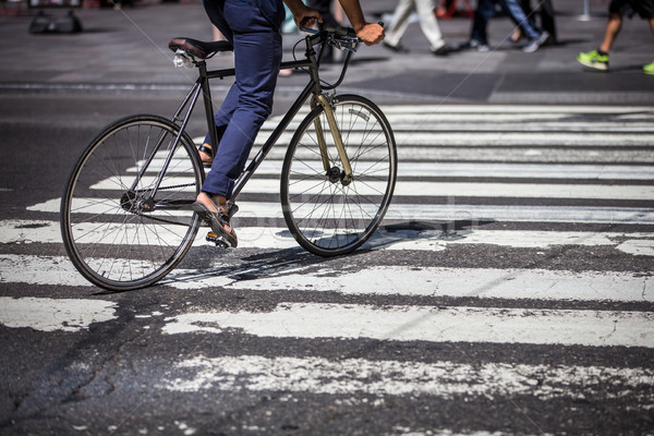 Man on a bike on a crossing in Manhattan, NYC Stock photo © lightpoet