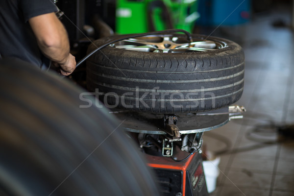 Tyre change - wheel balancing or repair and change car tire  Stock photo © lightpoet