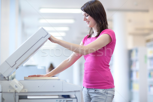 pretty young woman using a copy machine (shallow DOF; color tone Stock photo © lightpoet