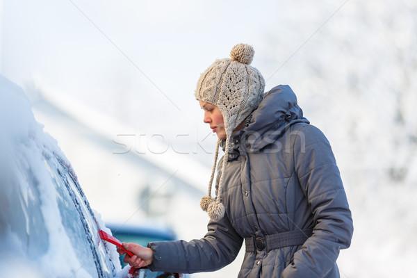Fiatal nő takarítás autó hó fagy tél Stock fotó © lightpoet