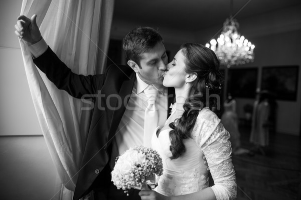 Gorgeous wedding couple kissing Stock photo © lightpoet