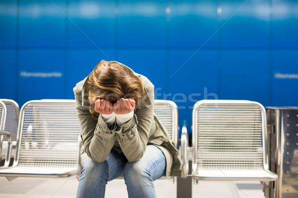 Lehangolt fiatal nő ül metró állomás szomorú Stock fotó © lightpoet